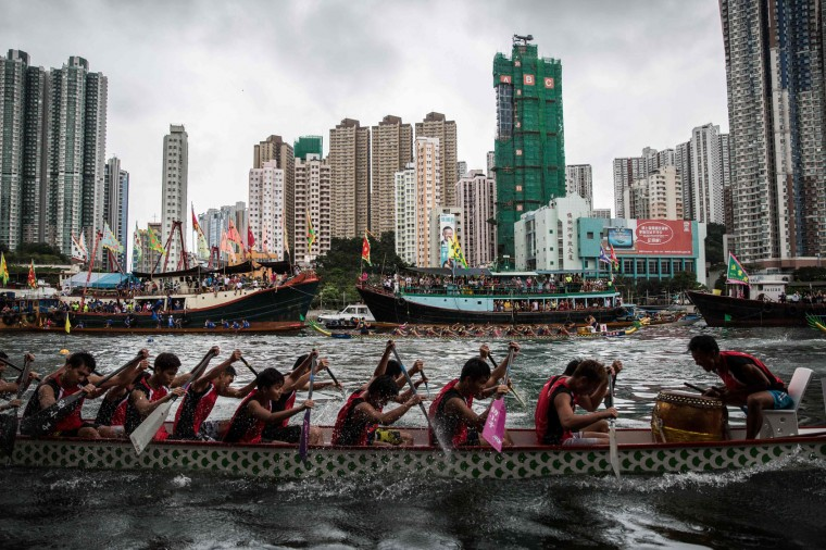 Teammates paddles during a dragon boat race held to celebrate the Tuen Ng festival in Hong Kong on June 9, 2016. (Anthony Wallace/AFP/Getty Images)