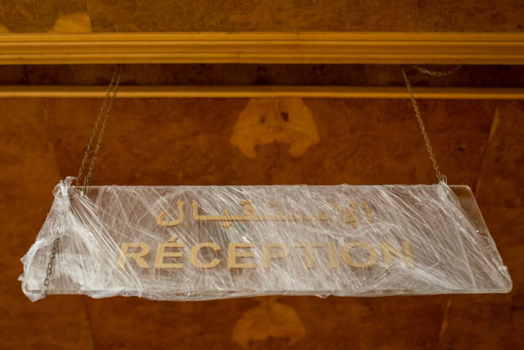 A new reception sign is seen wrapped in plastic at the closed Imperial Marhaba Hotel on June 24, 2016 in Sousse, Tunisia. The Imperial Marhaba hotel was the main target of the 2015 Sousse beach terrorist attack that killed 38 people including 30 Britons. The hotel attempted to stay open for three months after the attacks, however low occupancy forced the hotel to close. Since then it has operated with a skeleton staff, who work to maintain the rooms and grounds, other permanent hotel staff were able to be placed in temporary jobs at two other hotels owned by the same chain. The hotel hopes to open again by next spring or as soon as British travel advisories and restrictions are lifted for Tunisia. Before the 2011 revolution, tourism in Tunisia accounted for approximately 7% of the countries GDP. The two 2015 terrorist attacks at the Bardo Museum and Sousse Beach saw tourism numbers plummet even further forcing hotels to close and many tourism and hospitality workers to lose their jobs. The 26th of June 2016 marks the anniversary of the Sousse beach attacks. (Photo by Chris McGrath/Getty Images)
