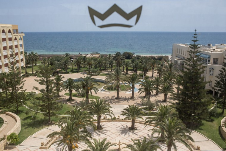 The grounds of the closed Imperial Marhaba Hotel are seen from a fourth floor window on June 24, 2016 in Sousse, Tunisia. The Imperial Marhaba hotel was the main target of the 2015 Sousse beach terrorist attack that killed 38 people including 30 Britons. The hotel attempted to stay open for three months after the attacks, however low occupancy forced the hotel to close. Since then it has operated with a skeleton staff, who work to maintain the rooms and grounds, other permanent hotel staff were able to be placed in temporary jobs at two other hotels owned by the same chain. The hotel hopes to open again by next spring or as soon as British travel advisories and restrictions are lifted for Tunisia. Before the 2011 revolution, tourism in Tunisia accounted for approximately 7% of the countries GDP. The two 2015 terrorist attacks at the Bardo Museum and Sousse Beach saw tourism numbers plummet even further forcing hotels to close and many tourism and hospitality workers to lose their jobs. The 26th of June 2016 marks the anniversary of the Sousse beach attacks. (Photo by Chris McGrath/Getty Images)