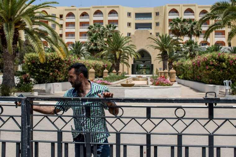 A security guard closes the front gate at the closed Imperial Marhaba Hotel on June 24, 2016 in Sousse, Tunisia. The Imperial Marhaba hotel was the main target of the 2015 Sousse beach terrorist attack that killed 38 people including 30 Britons. The hotel attempted to stay open for three months after the attacks, however low occupancy forced the hotel to close. Since then it has operated with a skeleton staff, who work to maintain the rooms and grounds, other permanent hotel staff were able to be placed in temporary jobs at two other hotels owned by the same chain. The hotel hopes to open again by next spring or as soon as British travel advisories and restrictions are lifted for Tunisia. Before the 2011 revolution, tourism in Tunisia accounted for approximately 7% of the countries GDP. The two 2015 terrorist attacks at the Bardo Museum and Sousse Beach saw tourism numbers plummet even further forcing hotels to close and many tourism and hospitality workers to lose their jobs. The 26th of June 2016 marks the anniversary of the Sousse beach attacks. (Photo by Chris McGrath/Getty Images)