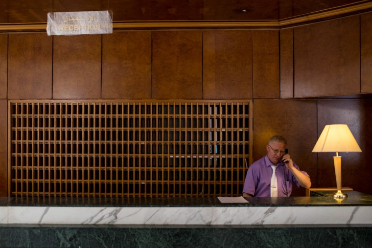 A man tends the reception desk at the closed Imperial Marhaba Hotel on June 24, 2016 in Sousse, Tunisia. The Imperial Marhaba hotel was the main target of the 2015 Sousse beach terrorist attack that killed 38 people including 30 Britons. The hotel attempted to stay open for three months after the attacks, however low occupancy forced the hotel to close. Since then it has operated with a skeleton staff, who work to maintain the rooms and grounds, other permanent hotel staff were able to be placed in temporary jobs at two other hotels owned by the same chain. The hotel hopes to open again by next spring or as soon as British travel advisories and restrictions are lifted for Tunisia. Before the 2011 revolution, tourism in Tunisia accounted for approximately 7% of the countries GDP. The two 2015 terrorist attacks at the Bardo Museum and Sousse Beach saw tourism numbers plummet even further forcing hotels to close and many tourism and hospitality workers to lose their jobs. The 26th of June 2016 marks the anniversary of the Sousse beach attacks. (Photo by Chris McGrath/Getty Images)