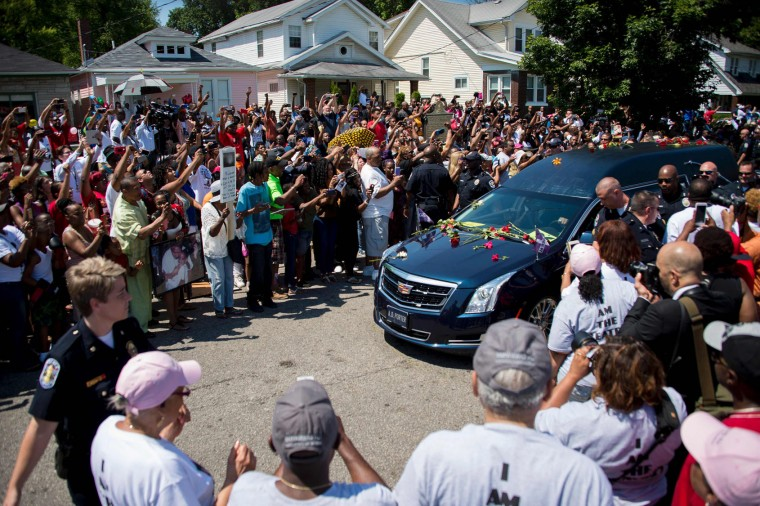 The hearse carrying boxing legend Muhammad Ali stops outside his childhood home where mourners wait to pay their respects on June 10, 2016 in Louisville, Kentucky. Thousands of people from near and far were expected to line the streets of Muhammad Ali's hometown Louisville on Friday to say goodbye to the boxing legend and civil rights hero, who mesmerized the world with his dazzling skills. (Jim Watson/AFP/Getty Images)