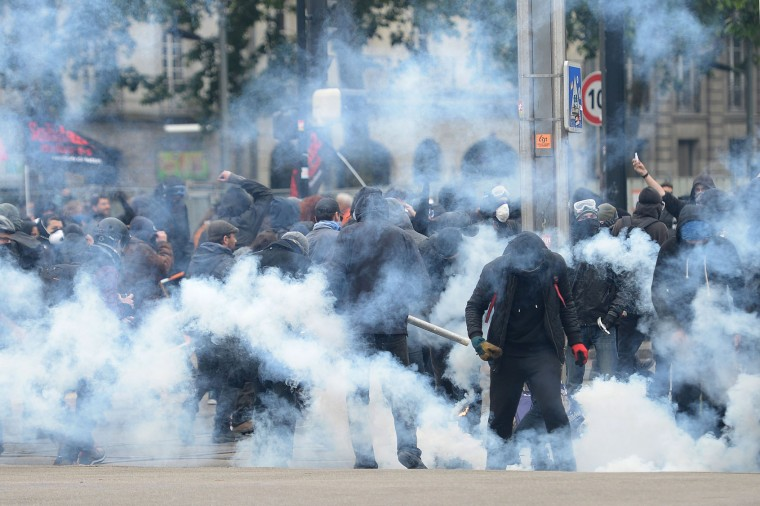 Masked men clash with French riot police during a demonstration against the government's planned labour law reforms on June 2, 2016 in Nantes, western France. More demonstrations against the reforms which the government says are designed to make France more business-friendly -- were set to take place in major cities on June 2 and nuclear power workers were back on strike at 16 of the country's 19 power stations. (Jean-Sebastien Evrard/AFP/Getty Images)
