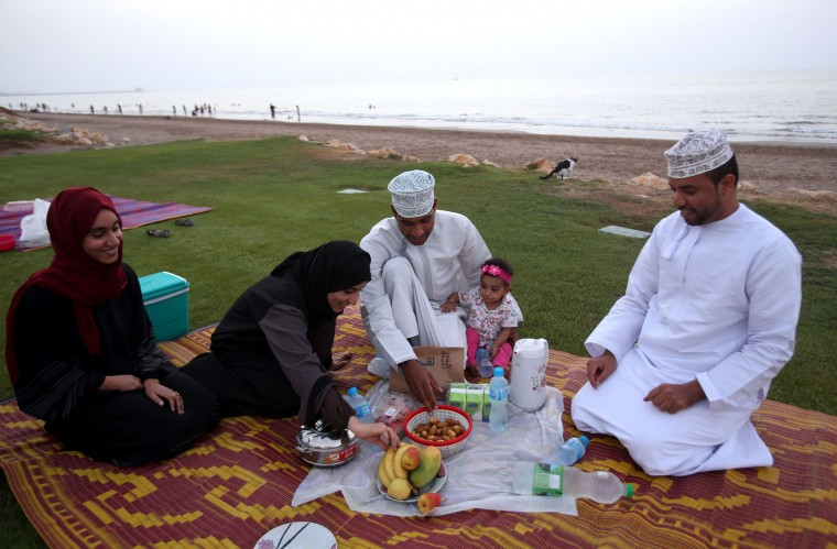 An Omani family gathers to break its fast at the beach in the capital Muscat on June 17, 2016 during the Muslim holy month of Ramadan. (Mohammed Mahjoub/AFP/Getty Images)