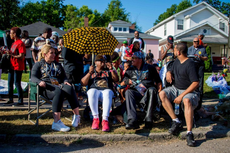 People sit in lawn chairs outside boxing legend Muhammad Ali's childhood home where mourners wait to pay their respects during a funeral procession on June 10, 2016 in Louisville, Kentucky. Thousands of people from near and far were expected to line the streets of Muhammad Ali's hometown Louisville on Friday to say goodbye to the boxing legend and civil rights hero, who mesmerized the world with his dazzling skills. (Jim Watson/AFP/Getty Images)