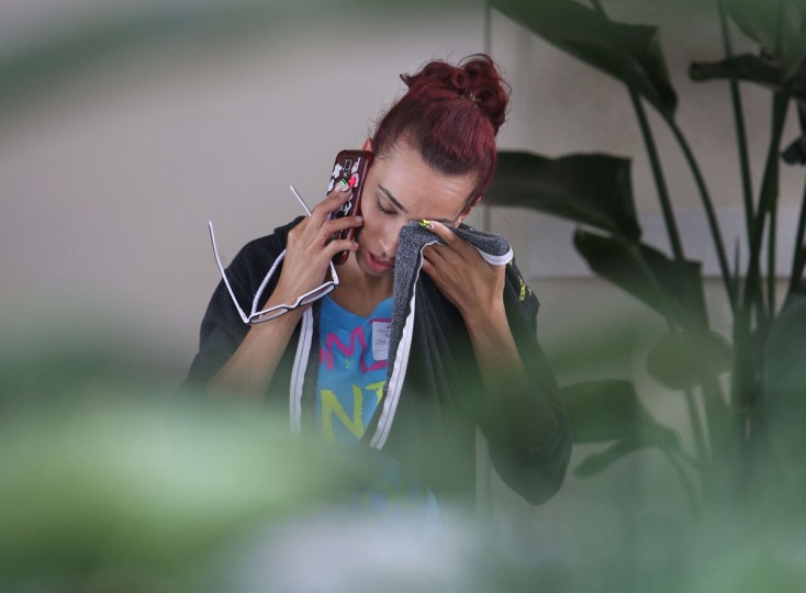 An person weeps outside the hotel where family members are gathering in Orlando, Florida after a mass shooting on June 12, 2016. Fifty people died and another 53 were injured when a gunman opened fire and seized hostages at a gay nightclub in Florida, police said June 12, making it the worst mass shooting in US history. (AFP PHOTO / Gregg NEWTON)