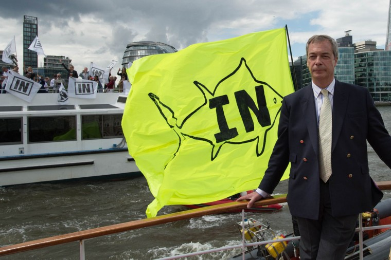 "Leader of the anti-EU Ukip party Nigel Farage poses on board a boat taking part in a leave the EU campaign ""flotilla"" on the River Thames, London. Wednesday June 15, 2016. In eight days time Britain goes to the polls in a referendum on whether Britain should remain or leave the EU. (Stefan Rousseau/PA via AP)"