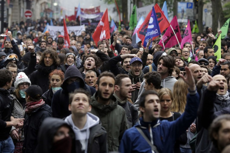 People attend a labor union demonstration against the French government and labor law reforms in Paris, Thursday, June 2, 2016. Workers are on strike at nearly all of France's nuclear plants and on the national rail service as part of months of protests over changes to labor protections. (AP Photo/Markus Schreiber)