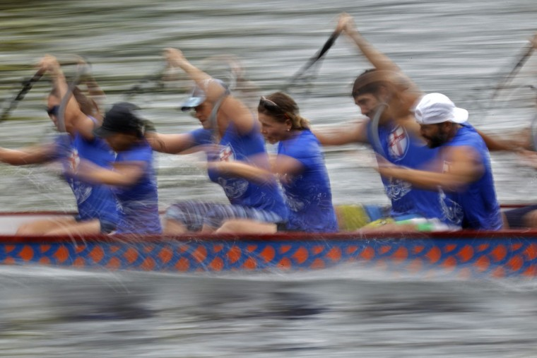 Participants compete in a dragon boat race in Hong Kong Thursday, June 9, 2016, as part of celebrations marking the Chinese Dragon Boat Festival, held throughout Hong Kong. (AP Photo/Vincent Yu)