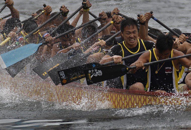 Participants compete in a dragon boat race in Hong Kong, Thursday, June 9, 2016, as part of celebrations marking the Chinese Dragon Boat Festival, held throughout Hong Kong. (AP Photo/Vincent Yu)