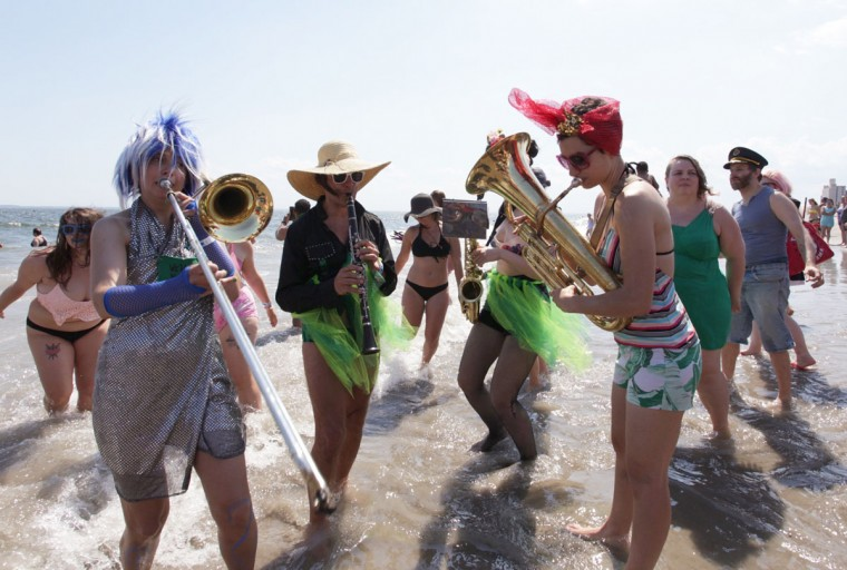 Members of the Brooklyn-based Rude Mechanical Orchestra Queer Solidarity Band entertain beach-goers after the 34th Annual Mermaid Parade at Coney Island in the Brooklyn borough of New York, Saturday, June 18, 2016. (AP Photo/Ezra Kaplan)