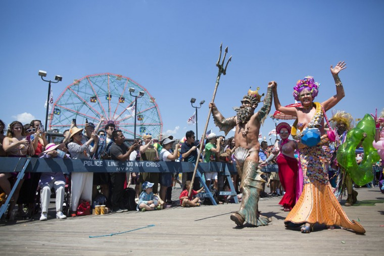 Participants march on the boardwalk during the 34th Annual Mermaid Parade, Saturday, June 18, 2016, in New York's Coney Island. (AP Photo/Mary Altaffer)