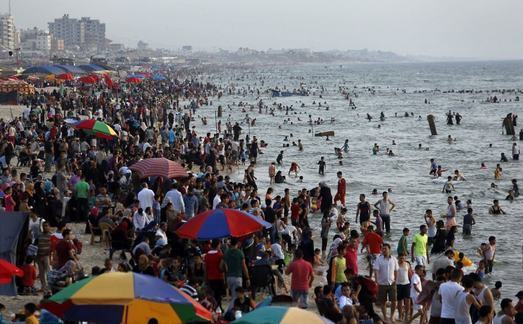 Palestinians enjoy their last Friday day before the Holy month of Ramadan, at the beach of the Mediterranean sea in Gaza City, Friday, June 3, 2016. (AP Photo/Hatem Moussa)