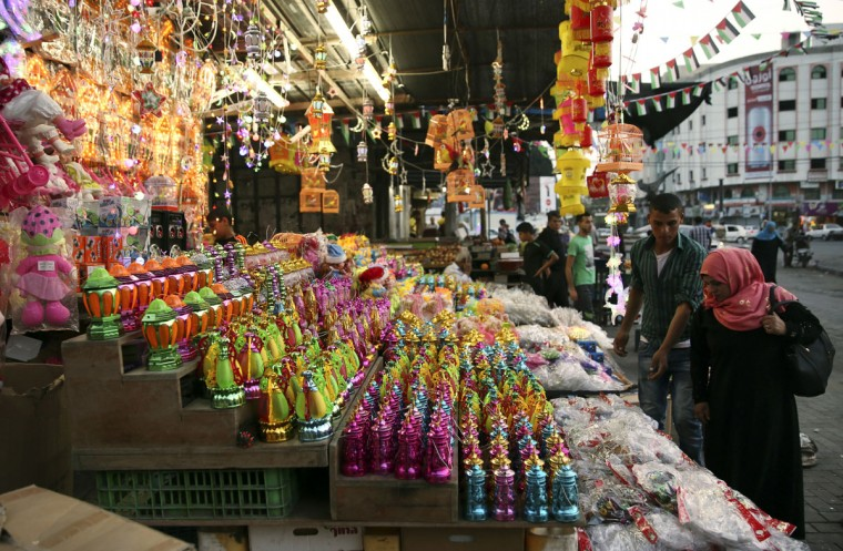 Palestinians buy traditional Ramadan lanterns to mark the holy month of Ramadan at main market in Gaza City, Friday, June 3, 2016. Devout Muslims throughout the world will begin to celebrate Ramadan next week, the holiest month in the Islamic calendar, refraining from eating, drinking, smoking and sex from sunrise to sunset. (AP Photo/Adel Hana)