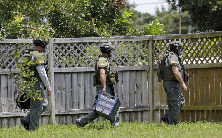 Bomb disposal officers check for bombs at an apartment complex of a suspect linked to the fatal shootings at an Orlando nightclub, Sunday, June 12, 2016, in Fort Pierce, Fla. (AP Photo/Alan Diaz)