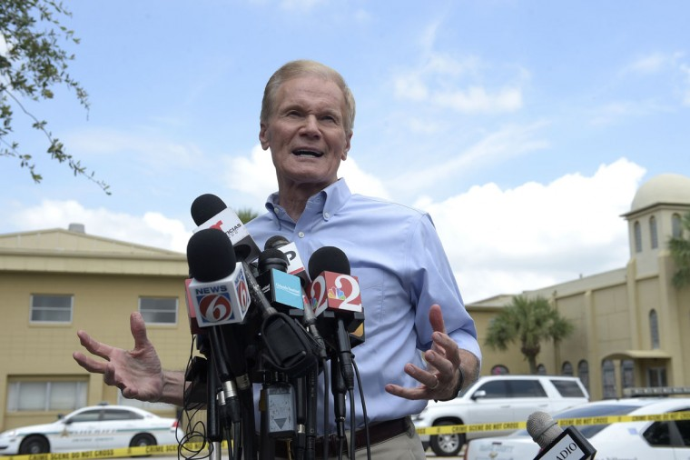Sen. Bill Nelson, D-Fla., addresses reporters during a news conference after a shooting involving multiple fatalities at a nightclub in Orlando, Fla., Sunday, June 12, 2016. (AP Photo/Phelan M. Ebenhack)