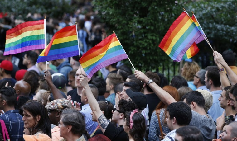 People hold rainbow colored gay pride flags during a vigil and memorial for victims of the Orlando nightclub shootings at the historic Stonewall Inn, Monday, June 13, 2016, in New York. State and city officials, LGBT community members, and others gathered as a show of solidarity with the victims and survivors of the Orlando nightclub shootings, the worst mass shooting in modern U.S. history. (AP Photo/Kathy Willens)