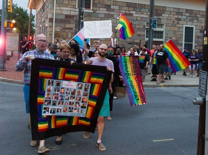 "People march as they gather for a ""Stand with Orlando"" vigil held by the LGBT Center of Central PA in Harrisburg, Pa., Monday, June 13, 2016. Vigils, rallies and marches are being held around the country Monday for the victims of early Sunday's deadly attack at a gay nightclub in Orlando. (Vicki Vellios Briner/PennLive.com via AP)"