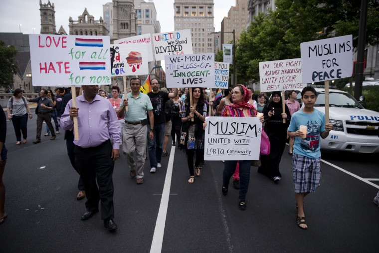 People march in memory of the victims of the Orlando, Fla., mass shooting, Monday, June 13, 2016, at City Hall in Philadelphia. A gunman opened fire inside a crowded gay nightclub early Sunday, before dying in a gunfight with SWAT officers, police said. (AP Photo/Matt Rourke)