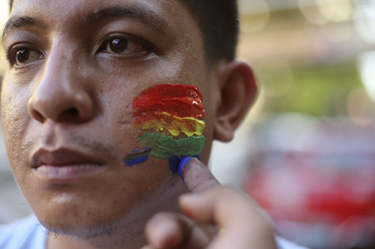 A Filipino youth activist has his face painted in rainbow colors as they gather in solidarity with victims of the mass shooting at the Pulse nightclub in Orlando, Florida during a gathering in Manila, Philippines on Tuesday June 14, 2016. The group calls for justice for the victims of the mass shooting. (AP Photo/Aaron Favila)