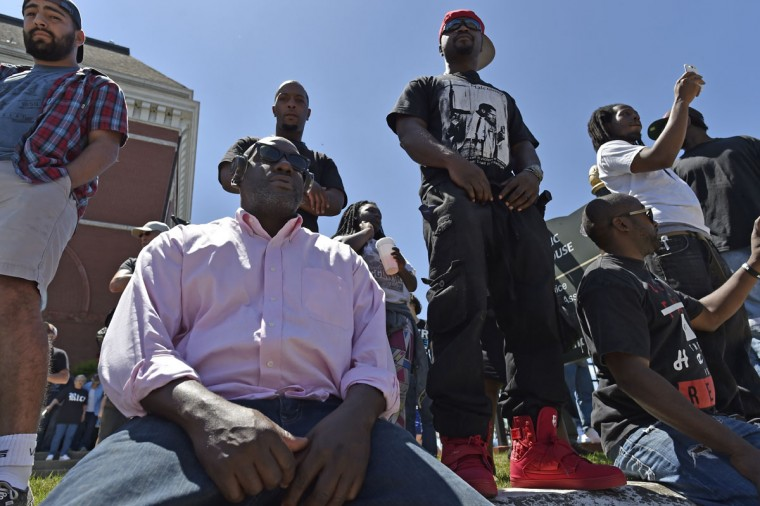 "In this April 23, 2016 photo, Vic Hicks, of Atlanta listens to the Klan speak during a ""White Pride,"" rally, in Rome, Ga. The Ku Klux Klan is trying to raise its hooded head 150 years after it was founded following the Civil War. The ease of online communication is helping the infamous white separatist movement reach new members, and issues important to the Klan like opposition to immigration are coming to the political forefront as the presidential election looms. (AP Photo/Mike Stewart)"