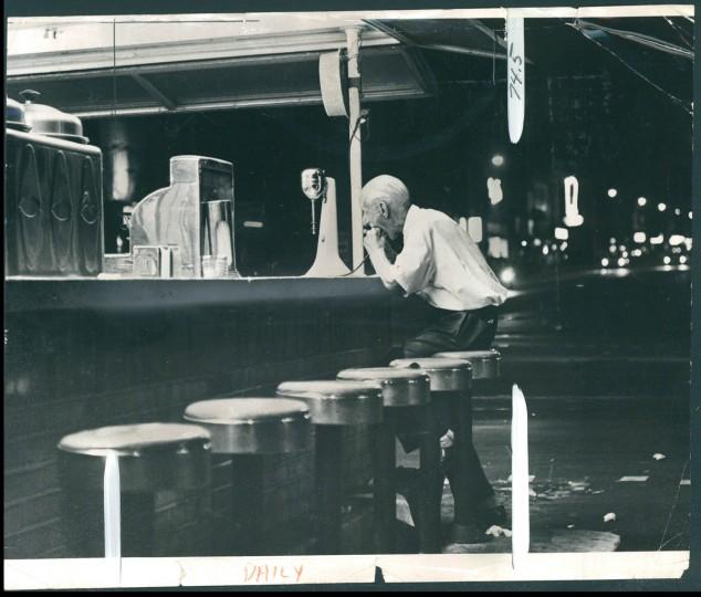 Man eats sandwich at outdoor restaurant at Broadway and Fleet, 1965. (Childress/Baltimore Sun)