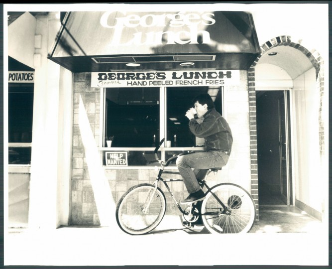A man rides his bike past George's Lunch in Rehoboth Beach on April 28, 1985. (Haddock/Baltimore Sun)