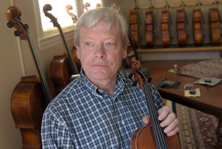 """Rodger Perrin, founder of Perrin and Associates Fine Violins in 1994, is pictured in one of the showrooms. The company makes, repairs and restores violins and cellos for the aspiring to the accomplished musician. Perrin says, """"I was passionate about Mozart and Beethoven when I was five years old."""" His love for classical music progressed from playing violins to building, restoring and repairing violins, violas and cellos. (Algerina Perna/Baltimore Sun)"""