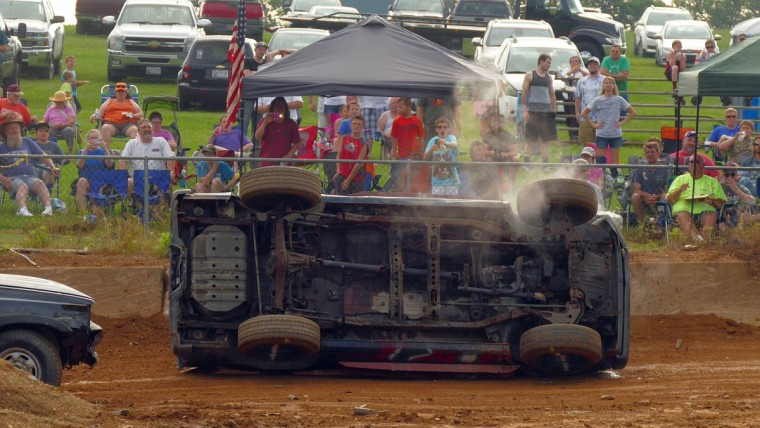 A vehicle rolls on its side while competing during Demo Derby Day at Arcadia Volunteer Fire Company's carnival grounds. (Karl Merton Ferron/Baltimore Sun)