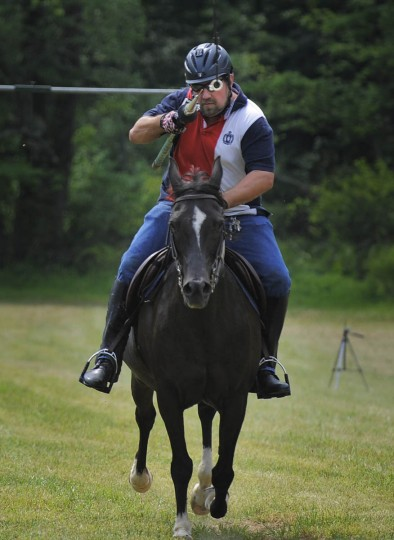 Randall McGill, president of Amateur Jousting Club of Maryland (AJC) readies to spear second of three rings aboard Taz (Kenneth K. Lam, Baltimore Sun)