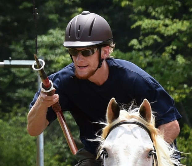 Phillip Kreutzer, of Delta, Pa., almost smiles as he spears a ring during Amateur Jousting Club of Maryland's 2016 Founder's Day Joust at the historic Jerusalem Mill Village. Traditional ring joust is a test of skill and horsemanship where riders pass through a series of arches, attempting to spear three dangling rings. Ring diameters range from one and three quarter inches for novices to one inch for professional jousters. Ring sizes go down to as small as a quarter inch to break ties in order to declare a winner. (Kenneth K. Lam, Baltimore Sun)