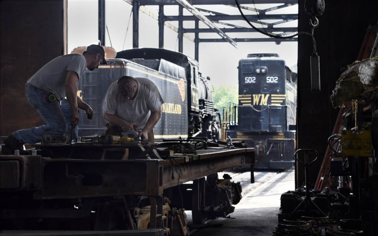 Bruce Snyder, left, mechanic, and Scott Nixon, right, shop foreman, work on the tender frame of the C&O railroad 1309 steam locomotive at the Western Maryland Scenic Railroad yard, where restoration work is being done on the train. When the restoration is complete, probably next year, the locomotive will pull passenger cars along the scenic railroad that runs between Cumberland and Frostburg. (Barbara Haddock Taylor, Baltimore Sun)