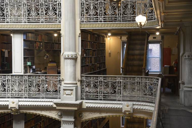 "The library's collection reflects the priorities and interests of patrons in the late 19th and early 20th centuries. ""It provides kind of a snapshot in time to what they thought was important,"" says curator Paul Espinosa. (Christina Tkacik/Baltimore Sun)"