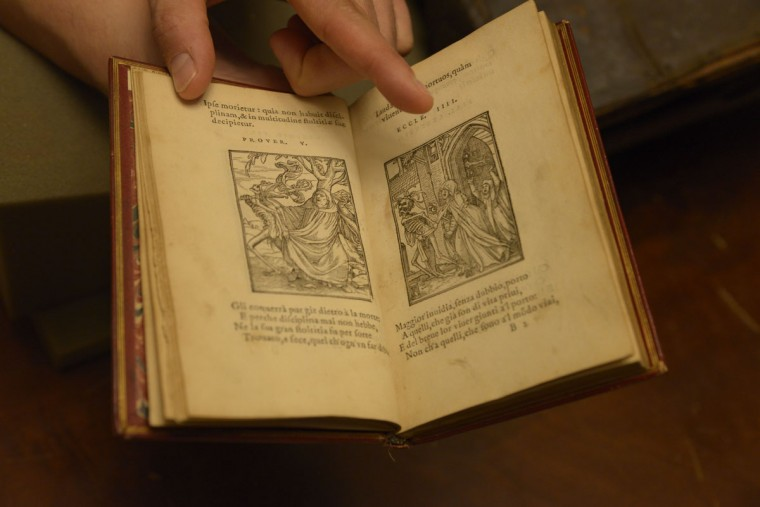 """This 1548 book in the Peabody's rare books room shows figures of death – with skeletons seen tormenting bishops and farmers alike. It's just one example of the memento mori tradition, which is meant to remind medieval readers: death comes for us all. """"Sometimes we lament that we weren't born 100 years earlier or 100 years later,"""" says Espinosa, alluding to the drawings. """"But when all is said and done we're pretty lucky."""" (Christina Tkacik/Baltimore Sun)"""