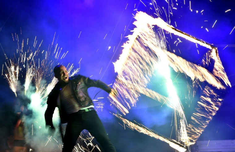 "A costumed artist performs with a cube fire during International Kiev Fire Fest show in Kiev on June 11, 2016. Teams from Greece, Belarus, Lithuania, Slovakia, USA, Czech Republic, Scotland and Ukraine, take part with their fire-shows in the two-day ""Kiev Fire Fest"" in Kiev. (AFP/Getty Images)"