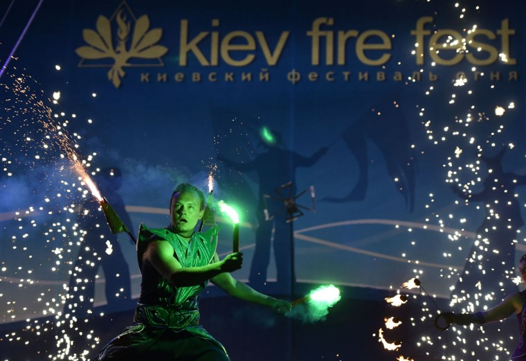 "A costumed artist performs with smoke flares during International Kiev Fire Fest show in Kiev on June 11, 2016. Teams from Greece, Belarus, Lithuania, Slovakia, USA, Czech Republic, Scotland and Ukraine, take part with their fire-shows in the two-day ""Kiev Fire Fest"" in Kiev. (AFP/Getty Images)"