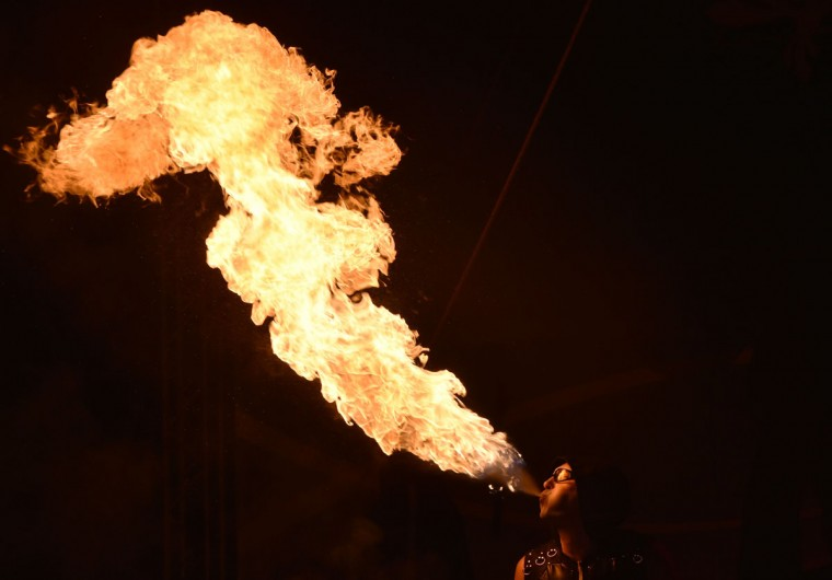 "A costumed artist performs with fire during International Kiev Fire Fest show in Kiev on June 11, 2016. Teams from Greece, Belarus, Lithuania, Slovakia, USA, Czech Republic, Scotland and Ukraine, take part with their fire-shows in the two-day ""Kiev Fire Fest"" in Kiev. (AFP/Getty Images)"