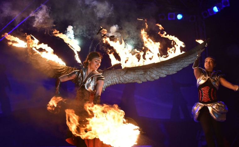 "Costumed artists perform with fire during International Kiev Fire Fest show in Kiev on June 11, 2016. Teams from Greece, Belarus, Lithuania, Slovakia, USA, Czech Republic, Scotland and Ukraine, take part with their fire-shows in the two-day ""Kiev Fire Fest"" in Kiev. (SERGEI SUPINSKY/AFP/Getty Images)"