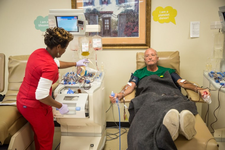 Orlando resident Scott Fuchs gives blood as phlebotomist Nicole Copeland tends to him at OneBlood in Orlando, Fla., on Sunday, June 12, 2016. The center was flooded with donors lined up around the corner to give blood after a mass shooting early Sunday morning at a club that left 50 dead and an additional 53 hospitalized and in need of blood. (Loren Elliott/Tampa Bay Times/Zuma Press/TNS)
