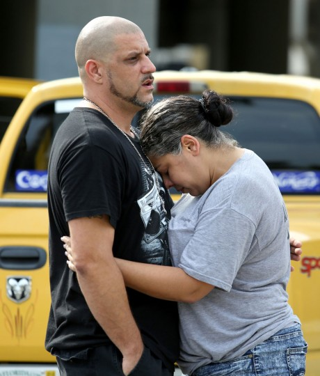 Ray Rivera, DJ at the Pulse nightclub, is consoled by a friend outside of the Orlando Police Department on Sunday, June 12, 2016. (Joe Burbank/Orlando Sentinel/TNS)