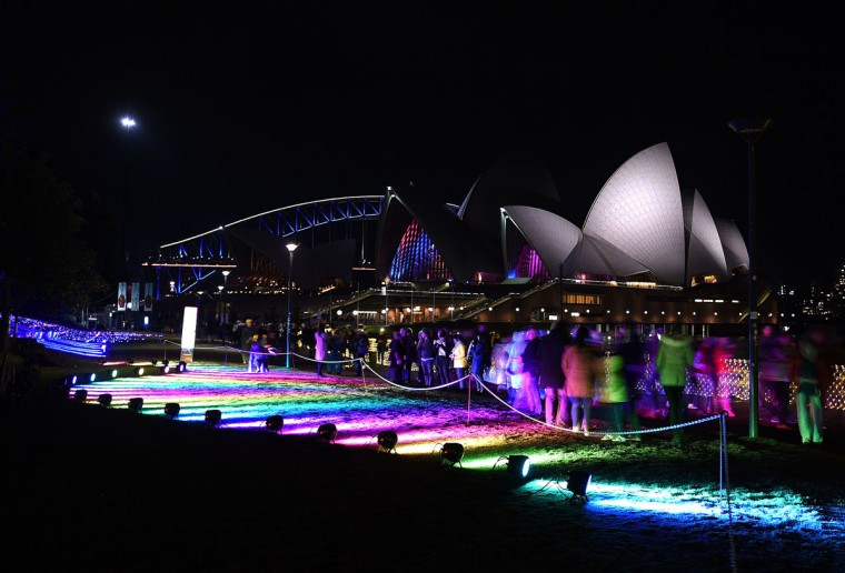 Visitors walk through the lit up Botanical Gardens during the Vivid Sydney festival on June 1, 2016. Vivid Sydney, an annual festival of light, music and ideas, runs from May 27 to June 18. (SAEED KHAN/AFP/Getty Images)