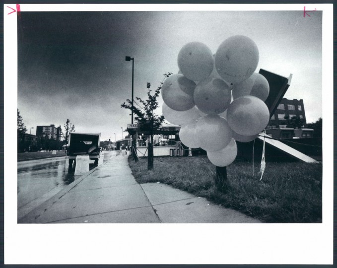 A lonely flock of balloons is left tied to an Artscape outdoor sculpture next to an empty food booth. June 14, 1982.
