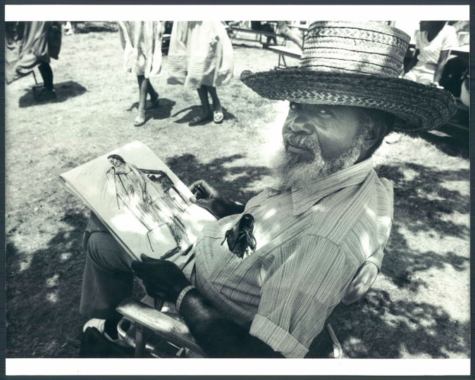 Hugh Harper tries a quick sketch of a performer-art on art at Artscape. 1983. (Phillips/Baltimore Sun)
