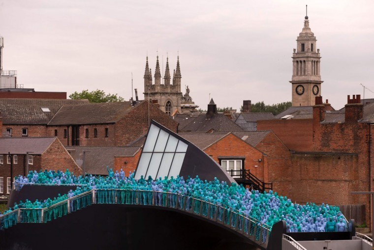 """Naked volunteers, painted in blue to reflect the colours found in Marine paintings in Hull's Ferens Art Gallery, prepare to participate in US artist, Spencer Tunick's """"Sea of Hull"""" installation in Kingston upon Hull on July 9, 2016. Over a period of 20 years, the New York based artist has created over 90 art installations in some of the most culturally significant places and landmarks around the world including the Sydney Opera House, Place des Arts in Montreal, Mexico City, Ernest Happel Stadium in Vienna and Munich in Germany. (AFP PHOTO / JON SUPER)"""