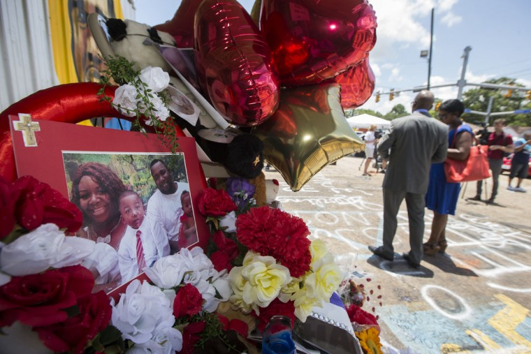 A photo of Alton Sterling and his family is displayed at a memorial outside the Triple S Mart on July 7, 2016 in Baton Rouge, Louisiana. Sterling was shot by a police officer in front of the Triple S Food Mart in Baton Rouge on July 5th, leading the Department of Justice to open a civil rights investigation. (Photo by Mark Wallheiser/Getty Images)