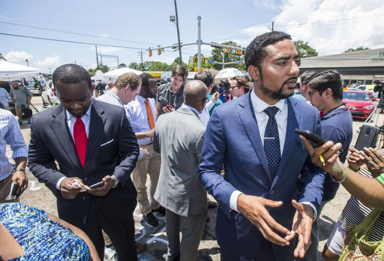 (L-R) Attorneys Dale Glover, L. Chris Stewart and Justin Bamberg speak to the media in front of the Triple S Mart on July 7, 2016 in Baton Rouge, Louisiana. Bamberg, Stewart and Glover are representing Alton Sterling's family, Quinyetta McMillon and 15 year-old son Cameron Sterling, after Sterling was shot by a police officer in front of the Triple S Food Mart in Baton Rouge on July 5th, leading the Department of Justice to open a civil rights investigation. (Photo by Mark Wallheiser/Getty Images)