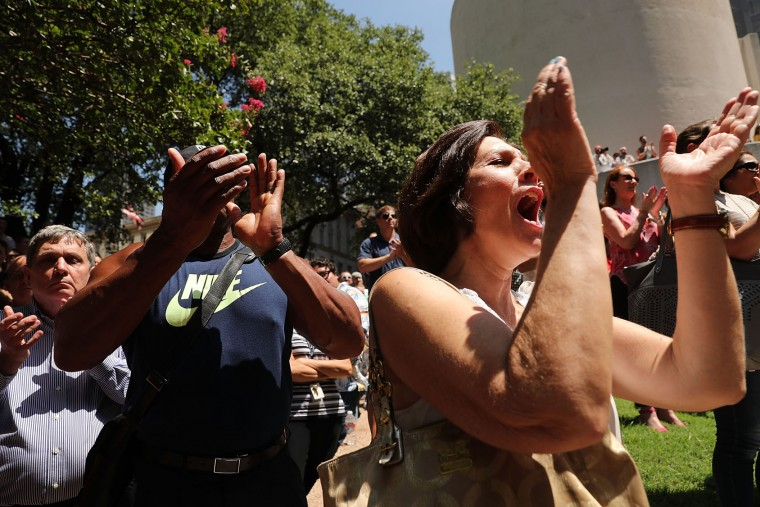 People gather in a prayer vigil following the shooting deaths of five police officers last night during a Black Live Matter march on July 8, 2016 in Dallas, Texas. Five police officers were killed and seven others were injured in a coordinated ambush at a anti-police brutality demonstration in Dallas. Investigators are saying the suspect is 25-year-old Micah Xavier Johnson of Mesquite, Texas. This is the deadliest incident for U.S. law enforcement since September 11. (Photo by Spencer Platt/Getty Images)