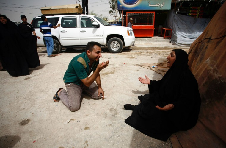Iraqis mourn after they lost five members of their family in a suicide bombing that ripped through Baghdad's busy shopping district of Karrada, during the funeral of the victims in the holy Iraqi city of Najaf on July 3, 2016. The blast hit the Karrada district early in the day as the area was packed with shoppers ahead of this week's holiday marking the end of the Muslim fasting month of Ramadan, killing at least 75 people in the deadliest single attack this year in Iraq's capital.(AFP PHOTO / Haidar HAMDANI)