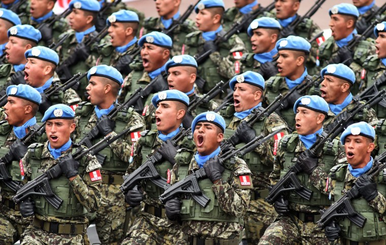 Members of Peruvian Army, attached to United Nations Blue Helmets Peace Forces, take part in a military parade to celebrate Peru¥s Independence Day in Lima on July 29, 2016. / (AFP Photo/Cris Bouroncle)