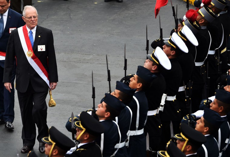 Peru's new President Pedro Pablo Kuczynski attends a military parade during Independence Day celebrations in Lima on July 29, 2016. / (AFP Photo/Cris Bouroncle)